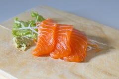 Fresh sashimi saimon on wood background Royalty Free Stock Images
