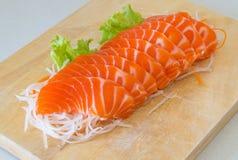 Fresh sashimi saimon on wood background Stock Photo