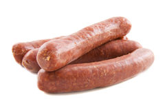 Fresh sausage. Raw red sausage isolated on a white background stock photography