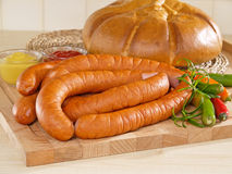 Fresh sausage on a cutting board with bread Stock Photos