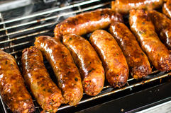 Fresh sausage and hot dogs grilling Stock Photo