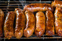 Fresh sausage and hot dogs grilling Royalty Free Stock Photography
