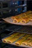 Fresh Sausage Rolls. Cooling on a rack Royalty Free Stock Image