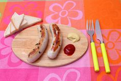 Fresh sausage. Some fresh snack of sausages with ketchup Royalty Free Stock Images