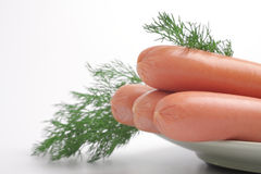 Fresh sausages on a plate. With fennel Stock Photos
