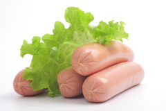 Fresh sausages with vegetables. Stock Image