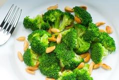 Fresh sauteed broccoli and almonds Stock Photos