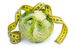 Fresh savoy cabbage with measuring tape isolated in white Stock Images