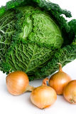 Fresh savoy cabbage and onions Stock Images