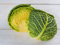 Fresh savoy cabbage. On wooden background Stock Images