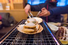 Fresh scallop grilled. Close up of fresh scallop or hotate grilled on the oven in local japanese restuarant Sapporo Hokkaido Japan Stock Image