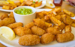 Fresh scampi and chips royalty free stock photography