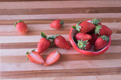 Fresh scatter strawberry in strawberry cup Stock Images