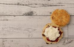 Fresh scone with cream and jam. With copy space stock image