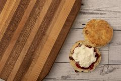 Fresh scone with jam and cream. Taken with copy space stock image
