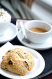 A fresh scone with raisins with coffee Royalty Free Stock Photos