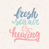 Fresh sea air is healing - hand drawn lettering phrase  on the beige grunge background. Fun brush ink. Inscription for photo overlays, greeting card or t-shirt Stock Photos