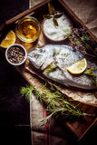 Fresh sea bream with condiments, herbs and spices Stock Photo