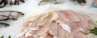 Fresh sea fish trout on ice. Photo toned Stock Image