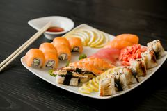 Fresh sea food at sushi restaurant. Free set of sushi. food reach in microcells. Japanise cuisine. raw seafood Royalty Free Stock Photos