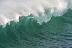 Fresh Sea Ocean Spray Waves. Breaking ocean wave whipped by offshore winds Stock Photography