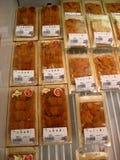 Fresh Sea urchin in retail pack. Osaka, Japan - June 1, 2015: Fresh Sea urchin in retail pack with price tag at Kuromon Ichiba market royalty free stock images