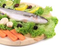 Fresh seabass on platter with lettuce. Isolated on a white background Royalty Free Stock Photo