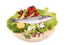 Fresh seabass on platter with lettuce. Isolated on a white background Stock Photo