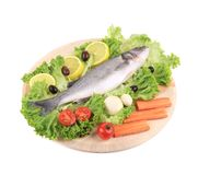 Fresh seabass on platter with lettuce. Isolated on a white background Royalty Free Stock Photos