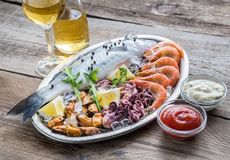 Fresh seabass with seafood on the tray Stock Photography