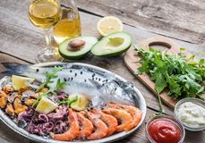 Fresh seabass with seafood on the tray Stock Photos