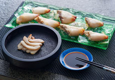 Fresh seafood. Arranged on a platter and in a pan next to sauce and chopsticks Stock Images