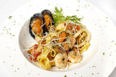 Fresh seafood black squid ink coulored spaghetti pasta tipycal italian food Stock Photo
