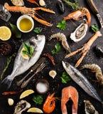 Fresh seafood on black stone. Stock Photo