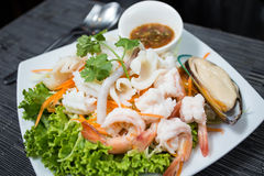 Fresh Seafood on dish. Serve with Spicy Seafood Sauce.It very delicious and spicy Royalty Free Stock Photo
