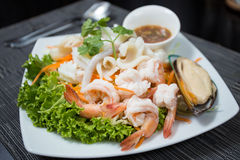 Fresh Seafood on dish. Serve with Spicy Seafood Sauce.It very delicious and spicy Stock Photos