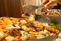 Fresh Seafood on ice in buffet line. A Fresh Seafood on ice in buffet line royalty free stock photo