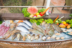 Fresh seafood on ice for cooking in restaurant Stock Photo