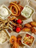 Fresh seafood plate. With dips and fried fish and vegetables royalty free stock photography
