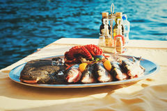 Fresh seafood plate in restaurant at sea Stock Photos