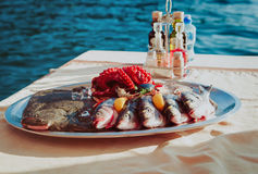Fresh seafood plate in restaurant at sea Stock Image