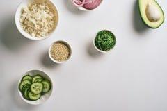 Fresh seafood recipe. Shrimp salmon poke bowl with cucumber, rice, avocado, chuka salad with white sesame. Food concept poke bowl stock images