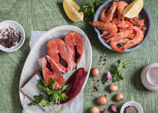 Fresh seafood - red fish and shrimp. Ingredients for cooking. On wooden background, top view. Royalty Free Stock Photos