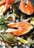 Fresh seafood: salmon steak, crabs and shrimps. Top view Stock Photo