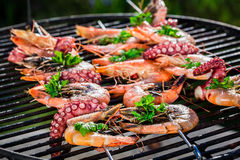Fresh seafood skewers with lemon and parsley for grilling Stock Photo