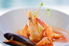Fresh seafood soup with accent on large single shrimp, close up Stock Photos