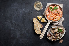 Fresh seafood on stone table. Scallops and shrimps Royalty Free Stock Photography