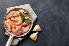 Fresh seafood on stone table. Shrimps. Top view with copy space stock images