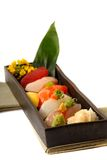 Fresh seafood sushi nigiri with lemon and flowers Royalty Free Stock Photos