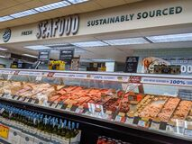 Fresh seafood, sustainably sourced, stocked in the deli and meat section of a Haggen grocery store